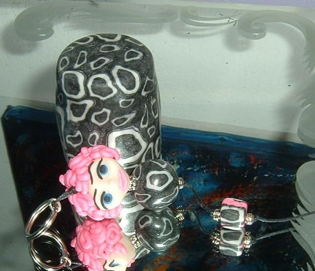 POupée medusette en fausse corsite dans son verre assorti
